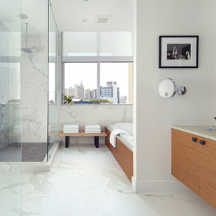 Large trendy master white tile and porcelain tile porcelain tile and white floor bathroom photo in Other with a vessel sink, flat-panel cabinets, light wood cabinets, quartz countertops, white walls, a one-piece toilet and a hinged shower door