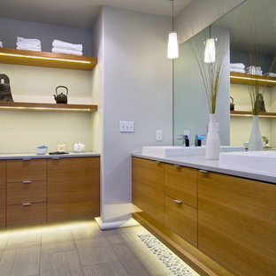 Example of a trendy gray tile bathroom design in Portland with a vessel sink, flat-panel cabinets and medium tone wood cabinets