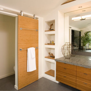 Example of a trendy toilet room design in Seattle with flat-panel cabinets and medium tone wood cabinets