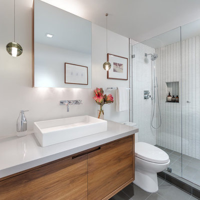 Alcove shower - small contemporary 3/4 white tile and ceramic tile porcelain tile alcove shower idea in Los Angeles with a vessel sink, medium tone wood cabinets, quartz countertops, a one-piece toilet, white walls and gray countertops
