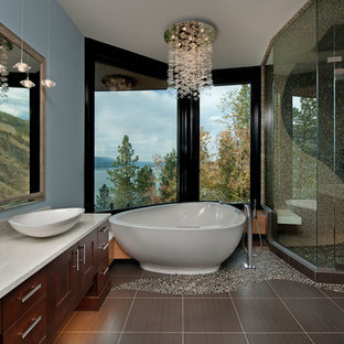 Inspiration for a contemporary gray tile and pebble tile pebble tile floor bathroom remodel in Vancouver with dark wood cabinets and blue walls