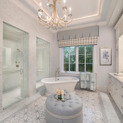 Bathroom - large traditional master white tile marble floor bathroom idea in Miami with an undermount sink, recessed-panel cabinets, white cabinets and gray walls