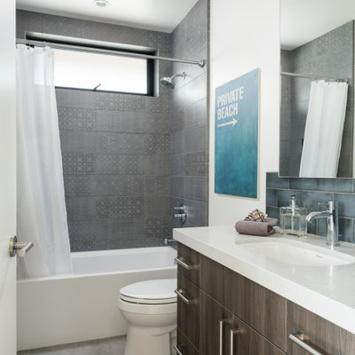 Bathroom - contemporary gray tile gray floor and single-sink bathroom idea in San Diego with flat-panel cabinets, gray cabinets, white walls, an undermount sink and white countertops
