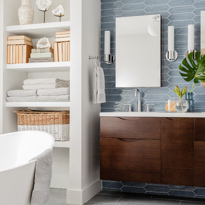 Inspiration for a contemporary master blue tile gray floor bathroom remodel in Boston with flat-panel cabinets, dark wood cabinets, white walls and an undermount sink