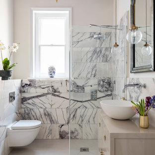 Inspiration for a medium sized traditional bathroom in London with freestanding cabinets, grey cabinets, a wall mounted toilet, white tiles, stone tiles, white walls, porcelain flooring, a vessel sink and wooden worktops.