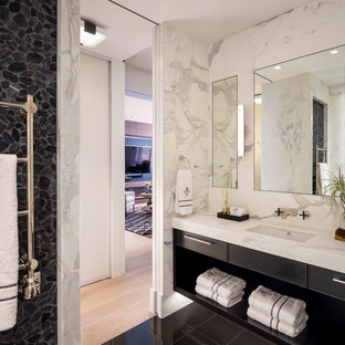 Example of a trendy black tile, gray tile, white tile and pebble tile black floor bathroom design in San Francisco with flat-panel cabinets, black cabinets, white walls, an undermount sink, marble countertops and white countertops