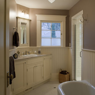 Example of a small arts and crafts black and white tile and ceramic tile ceramic floor freestanding bathtub design in Portland with shaker cabinets, white cabinets, a drop-in sink, marble countertops and brown walls