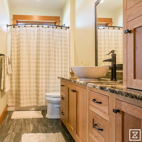tub a shower bathtub combo a two piece toilet beige walls slate