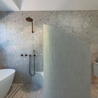 Photo of a large contemporary master wet room bathroom in Perth with shaker cabinets, white cabinets, a freestanding tub, a two-piece toilet, gray tile, porcelain tile, grey walls, porcelain floors, a vessel sink, engineered quartz benchtops, grey floor, an open shower and white benchtops.