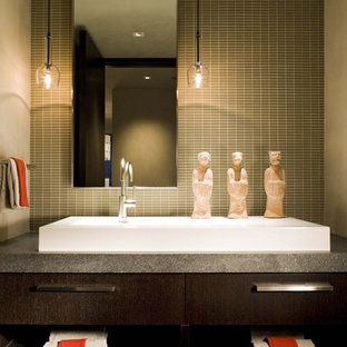 Inspiration for a small contemporary 3/4 beige tile and glass tile bathroom remodel in Denver with a drop-in sink, dark wood cabinets, beige walls, marble countertops and flat-panel cabinets