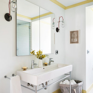 This is an example of a traditional family bathroom in New York with white walls, a console sink and painted wood flooring.