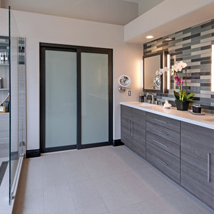 Bathroom - mid-sized contemporary master gray tile and glass tile porcelain floor bathroom idea in Orange County with flat-panel cabinets, gray cabinets, gray walls, an undermount sink and engineered quartz countertops
