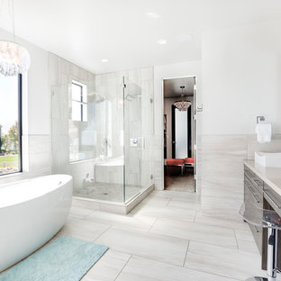 Example of a trendy gray tile gray floor bathroom design in Salt Lake City with flat-panel cabinets, gray cabinets, white walls, a vessel sink, a hinged shower door and beige countertops