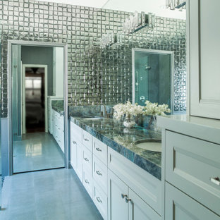 Inspiration for a mid-sized contemporary master bathroom in Houston with recessed-panel cabinets, white cabinets, a curbless shower, metal tile, porcelain floors, an undermount sink, marble benchtops, beige floor, an open shower, multi-coloured benchtops, a double vanity and a built-in vanity.