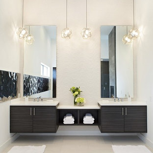 Inspiration for a large contemporary master white tile gray floor bathroom remodel in Houston with flat-panel cabinets, black cabinets, white walls, an undermount sink, engineered quartz countertops and white countertops