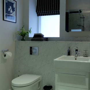 Photo of a small contemporary ensuite bathroom in London with a walk-in shower, a wall mounted toilet, grey tiles, grey walls, marble flooring, a wall-mounted sink and marble worktops.
