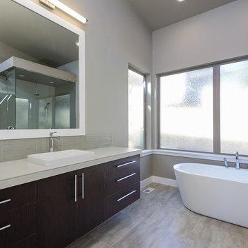 Contemporary master bathroom with walk-in closet