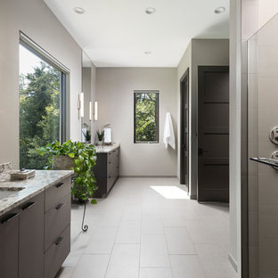 Bathroom - contemporary master gray floor bathroom idea in Detroit with flat-panel cabinets, gray walls, an undermount sink, multicolored countertops and dark wood cabinets