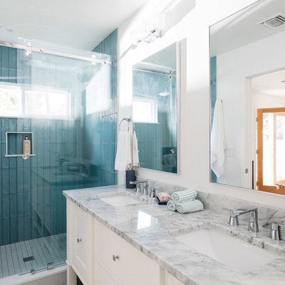 Open shower - transitional blue tile and porcelain tile open shower idea in Los Angeles with recessed-panel cabinets, white cabinets, white walls, an undermount sink, marble countertops and multicolored countertops