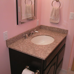 Small trendy 3/4 white tile and ceramic tile porcelain floor alcove shower photo in Denver with a drop-in sink, raised-panel cabinets, dark wood cabinets, granite countertops, a two-piece toilet and pink walls