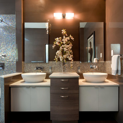 Bathroom - large contemporary master brown tile and ceramic tile ceramic tile bathroom idea in Other with a vessel sink, flat-panel cabinets, white cabinets, brown walls and quartz countertops