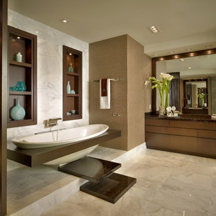 Drop-in bathtub - contemporary stone tile and white tile drop-in bathtub idea in Miami with a drop-in sink, flat-panel cabinets, dark wood cabinets and granite countertops