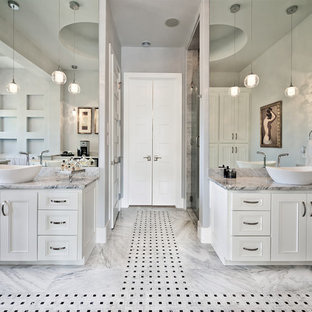 Example of a classic master bathroom design in Austin with a vessel sink, beaded inset cabinets, white cabinets and gray walls
