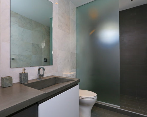 gray tile bathroom idea in tampa with flatpanel cabinets concrete countertops