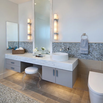 Example of a trendy multicolored tile and mosaic tile mosaic tile floor bathroom design in San Francisco with flat-panel cabinets, gray cabinets, a one-piece toilet, gray walls and a vessel sink
