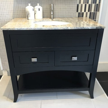 Contemporary vanity cabinets with granite counter top and under mount oval white
