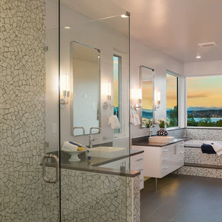 Trendy master gray tile and mosaic tile gray floor bathroom photo in Seattle with flat-panel cabinets, white cabinets, white walls, a vessel sink, a hinged shower door and gray countertops