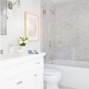 Elegant gray tile bathroom photo in Los Angeles with furniture-like cabinets, white cabinets, white walls and an undermount sink