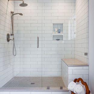 Inspiration for a mid-sized transitional master bathroom in Other with shaker cabinets, white cabinets, an alcove shower, a two-piece toilet, white tile, porcelain tile, white walls, travertine floors, a drop-in sink, solid surface benchtops, beige floor and a hinged shower door.