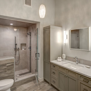 Inspiration for a large contemporary master porcelain tile porcelain tile bathroom remodel in San Francisco with an undermount sink, shaker cabinets, gray cabinets, quartz countertops, a one-piece toilet and white walls