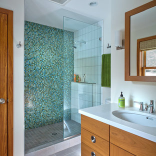 Alcove shower - 1960s 3/4 multicolored tile and ceramic tile porcelain floor alcove shower idea in Minneapolis with an undermount sink, flat-panel cabinets, medium tone wood cabinets, quartzite countertops, a two-piece toilet and white walls