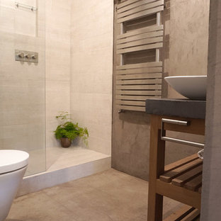 Small industrial ensuite bathroom in London with open cabinets, grey cabinets, a walk-in shower, beige tiles, ceramic tiles, grey walls, concrete flooring and concrete worktops.