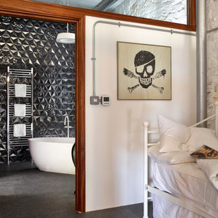 Inspiration for a medium sized bohemian family bathroom in Devon with a console sink, freestanding cabinets, black cabinets, a freestanding bath, black tiles, mosaic tiles and white walls.