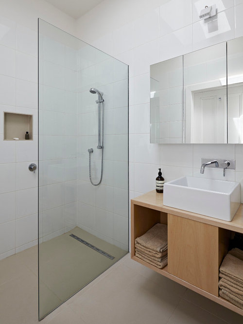 Example Of A Trendy White Tile Walk In Shower Design In Melbourne With A  Vessel