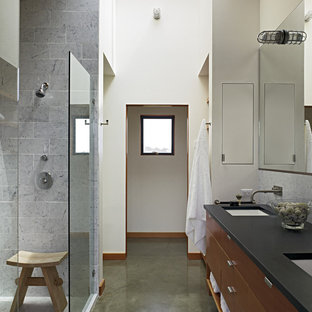 Example Of A Trendy Gray Tile Concrete Floor Doorless Shower Design In San Francisco With An