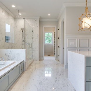 Inspiration for a huge transitional master gray tile and marble tile white floor and marble floor bathroom remodel in Nashville with shaker cabinets, white walls, a hinged shower door, blue cabinets, marble countertops and white countertops