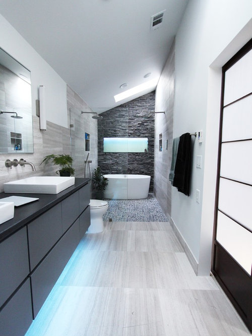 tub gray tile stone tile limestone floors and white walls