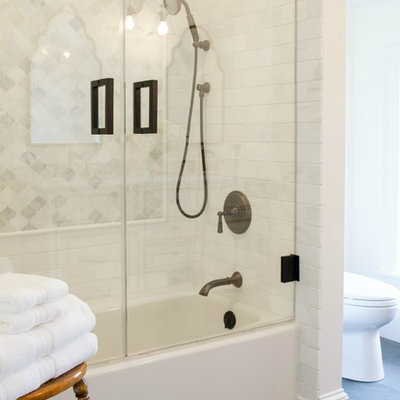 Mid-sized elegant master white tile and stone tile slate floor bathroom photo in New York with a one-piece toilet, white walls, an undermount sink and marble countertops