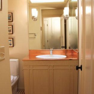 На фото: маленькая ванная комната в стиле фьюжн с накладной раковиной, фасадами островного типа, бежевыми фасадами, столешницей из меди, накладной ванной, душем над ванной, раздельным унитазом, разноцветной плиткой, плиткой мозаикой, бежевыми стенами и мраморным полом с