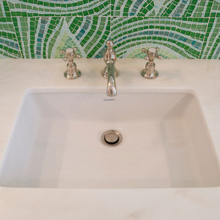 Inspiration for a medium sized family bathroom in Miami with flat-panel cabinets, green cabinets, marble worktops, glass tiles, green walls and mosaic tile flooring.