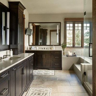 Large mountain style master beige tile beige floor and single-sink bathroom photo in Denver with dark wood cabinets, white countertops, shaker cabinets, beige walls, an undermount sink and a built-in vanity