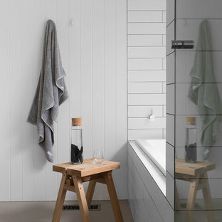Inspiration for a country bathroom in Melbourne with a drop-in tub, white tile and white walls.