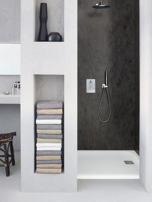 Example Of A Minimalist Bathroom Design In Other With Solid Surface  Countertops