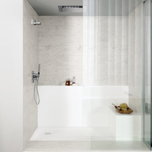 Inspiration for a modern bathroom remodel in Other with solid surface countertops