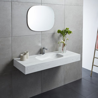 Bathroom - scandinavian bathroom idea in Sydney with an integrated sink and solid surface countertops