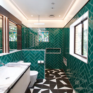 Design ideas for a large contemporary master bathroom in Brisbane with furniture-like cabinets, light wood cabinets, green tile, ceramic tile, white walls, ceramic floors, an undermount sink, an open shower, an alcove shower, a one-piece toilet, multi-coloured floor and grey benchtops.